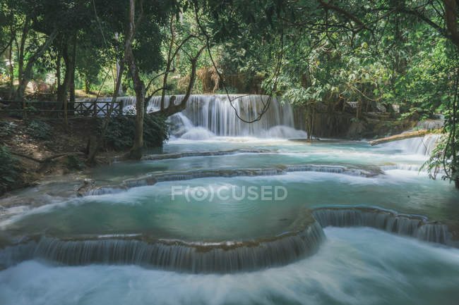 Idyllic waterfall with turquoise water at tropical forest — Stock Photo