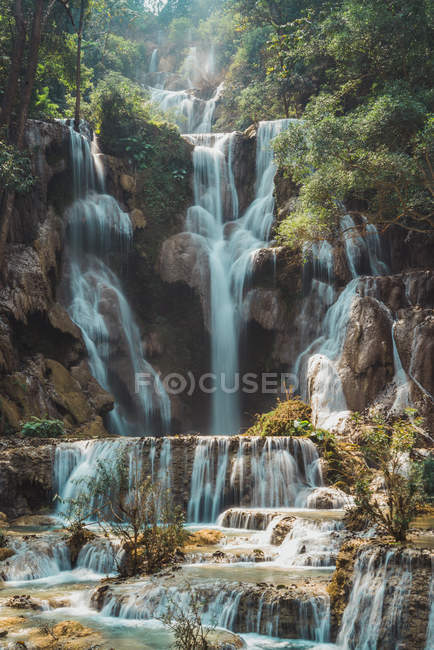 Scenic view to small tropical waterfalls in jungle — Stock Photo