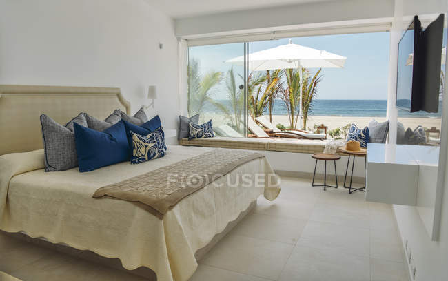 Comfortable big bedroom with furniture at villa on seaside. — Stock Photo