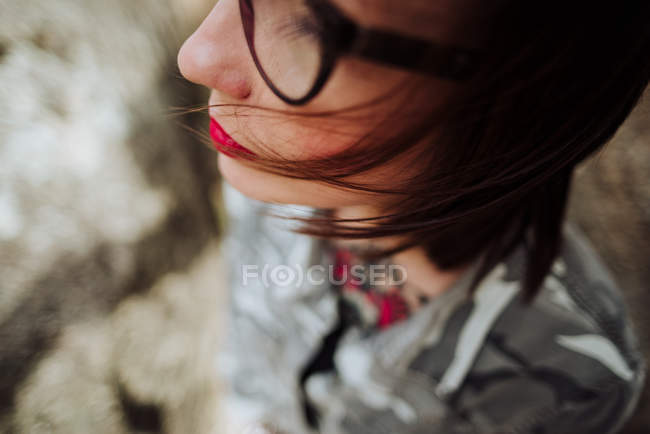 Crop woman in glasses posing at stones — Stock Photo