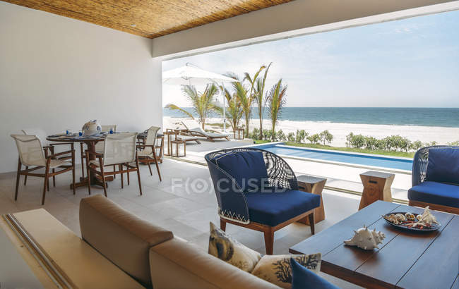 Interior view of patio with sofa and chairs — Stock Photo