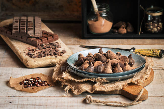 Still life of truffles and various chocolate on rustic table — Stock Photo