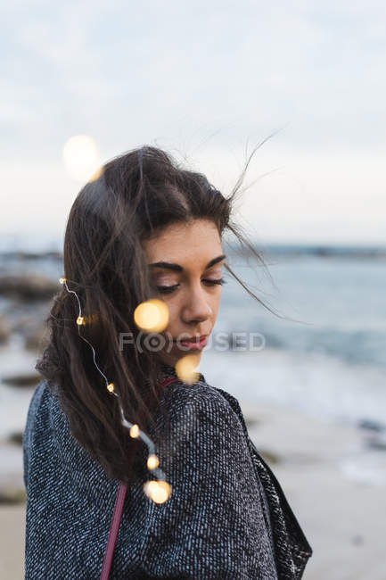 Dreamy woman with garland in hair posing at seaside — Stock Photo
