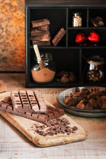 Table with various chocolates and truffles on plate — Stock Photo