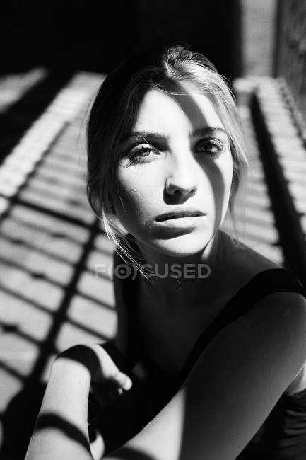Close-up portrait of woman in sunlight — Stock Photo