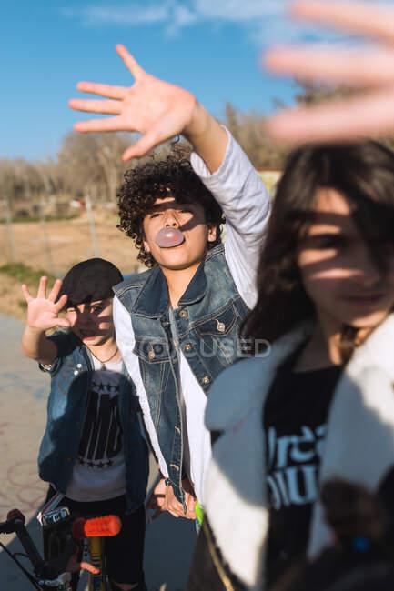 Trendy rebels kids standing in sunlight — Stock Photo