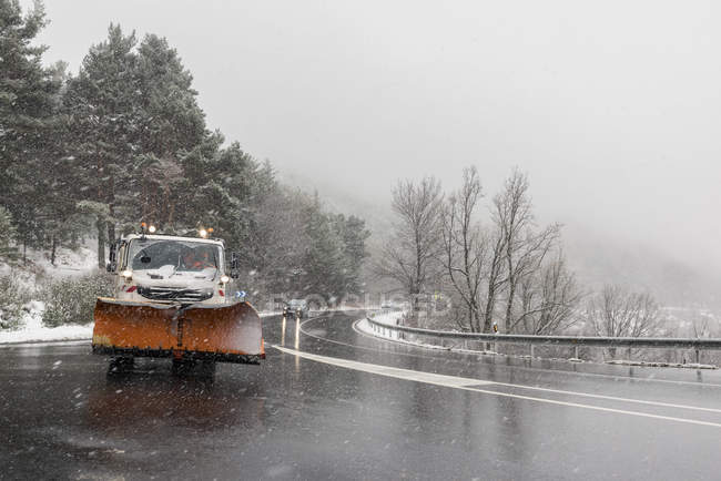 Snow plow removing snow during blizzard — Stock Photo