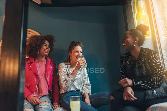 Multiracial women sitting in coffee shop — Stock Photo
