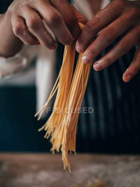Cook making spaghetti — Stock Photo