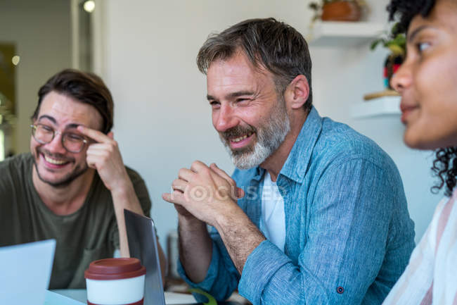Laughing colleagues in office — Stock Photo
