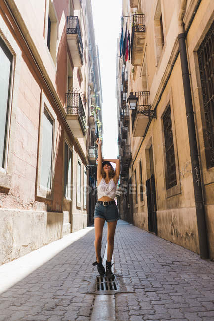 Woman standing on street — Stock Photo