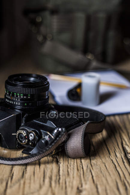 Analog camera on wooden table — Stock Photo