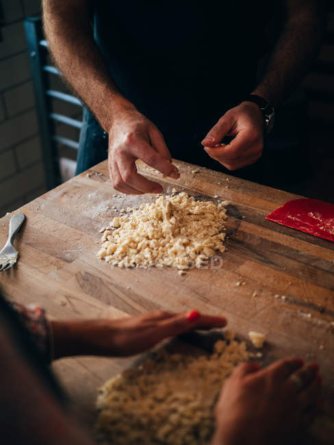 Cook preparing pasta in kitchen — Stock Photo