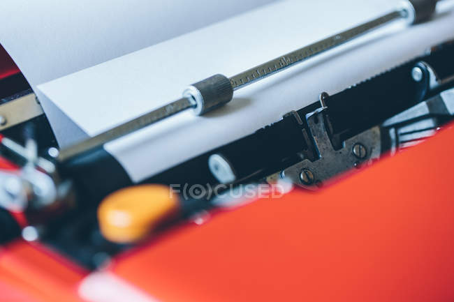 Blank paper sheet inserted into typewriter — Stock Photo