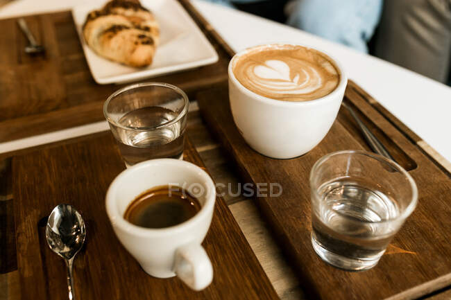 From above cups of coffee and croissant served on a table — Stock Photo