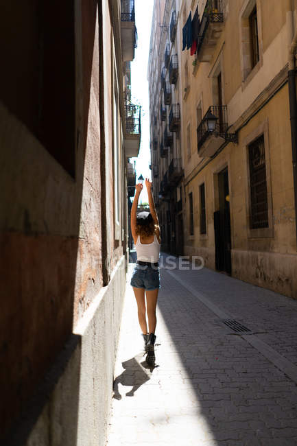 Funky young woman walking on street — Stock Photo