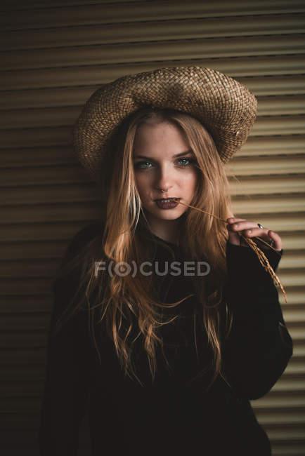 Sensual woman in straw hat — Stock Photo