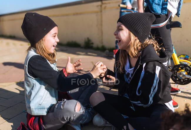 Playful girls on street having fun — Stock Photo