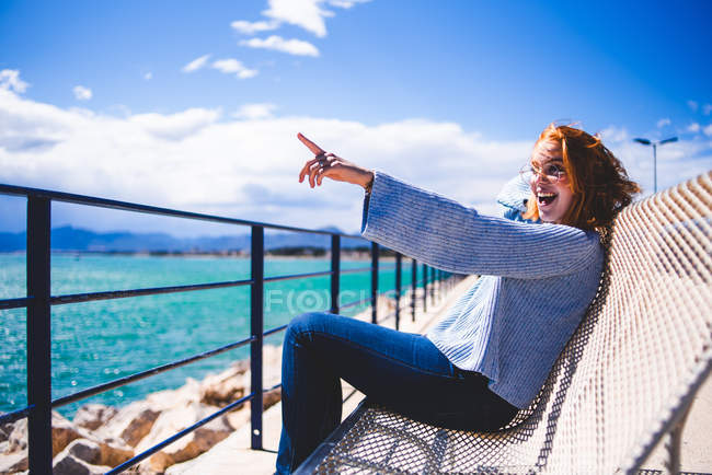 Redheaded woman relaxing at seaside — Stock Photo