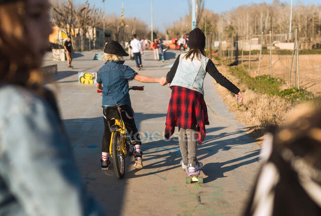 Playful stylish kids riding skateboard — Stock Photo