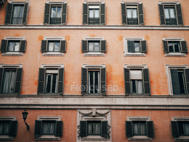 Orange building with shutters — Stock Photo