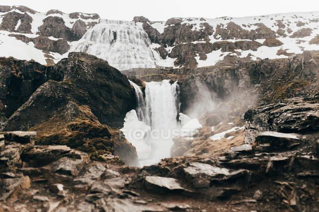 Waterfall flowing among rocks — Stock Photo