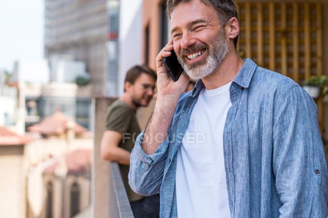 Bearded man talking phone — Stock Photo