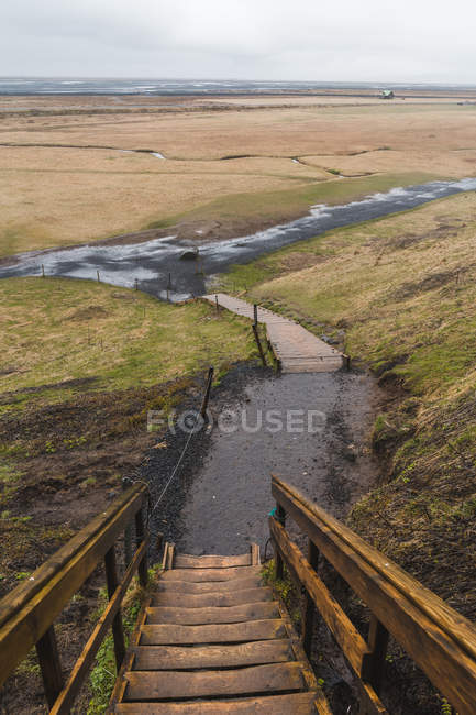 Stairs lumber stairway and Icelandic landscape — Stock Photo