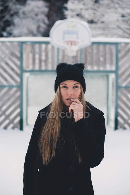 Woman standing in winter — Stock Photo