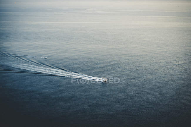 Boats in motion on sea surface — Stock Photo