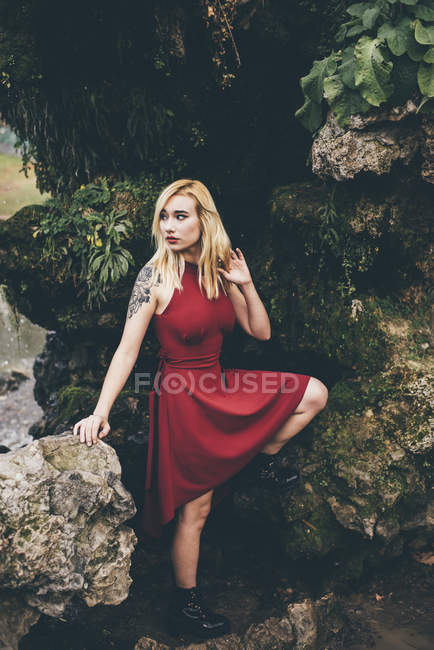 Blonde woman standing in nature — Stock Photo