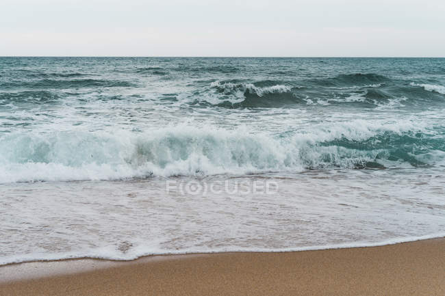 Wavy blue ocean and surf — Stock Photo