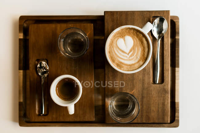 From above cups of coffee and croissant served on a table. — Stock Photo