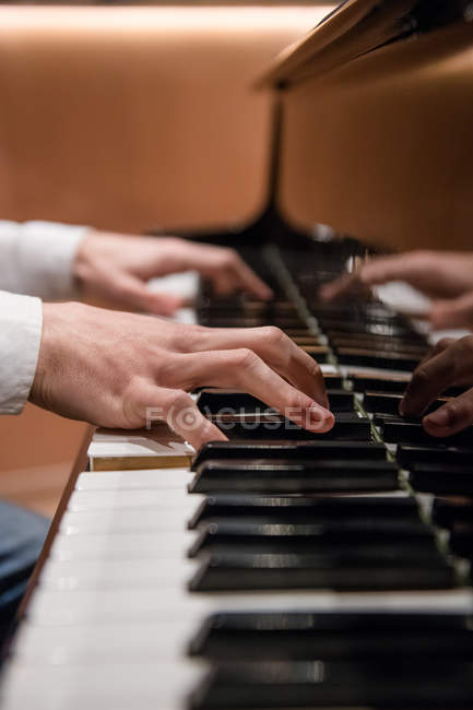 Musician playing piano — Stock Photo