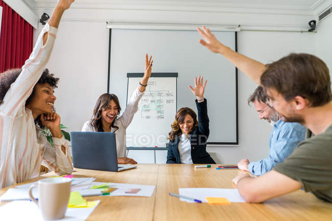 Colleagues voting at desk in office — Stock Photo
