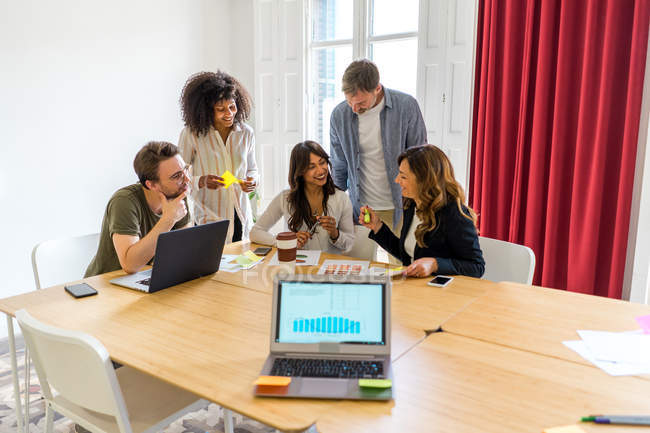 Colleagues discussing graphs — Stock Photo