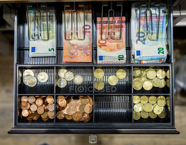 Cash and coins in till — Stock Photo