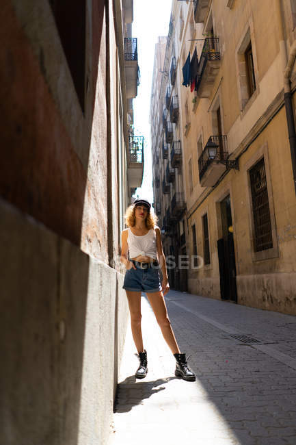 Woman in shorts and brutal boots on street — Stock Photo