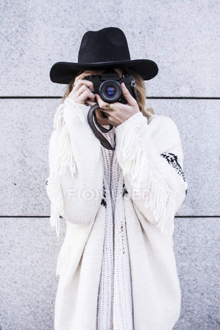 Woman with camera on street — Stock Photo