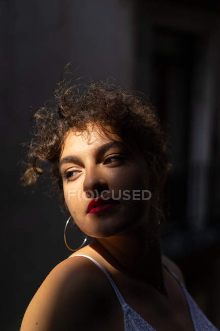 Curly woman with red lips — Stock Photo