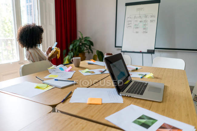 Businesswoman using smartphone in meeting room — Stock Photo
