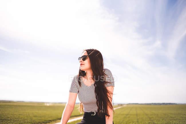 Woman enjoying weather in field — Stock Photo