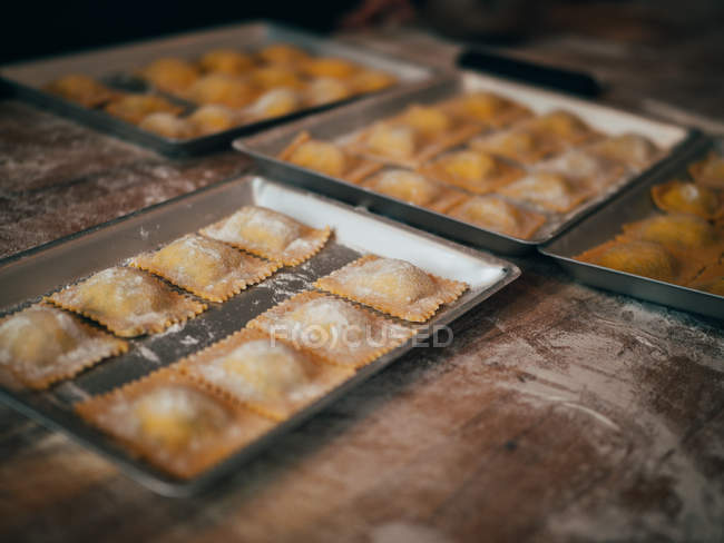 Prepared ravioli in trays — Stock Photo