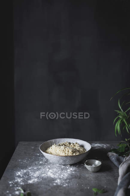 Dough in bowl on grey tabletop — Stock Photo