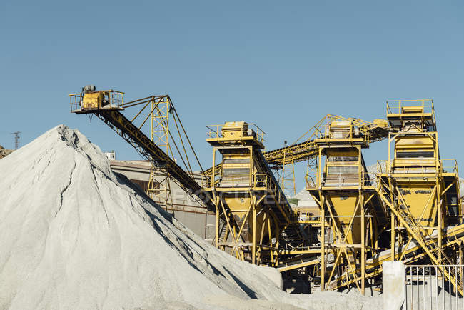 Machinery and industrial equipment in quarry in sunlight — Stock Photo