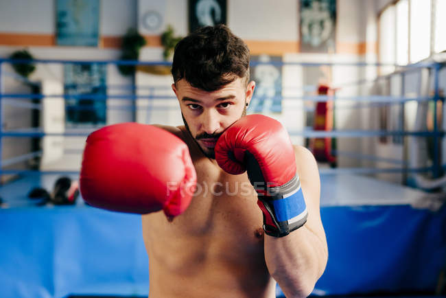 Fighter standing in gym — Stock Photo