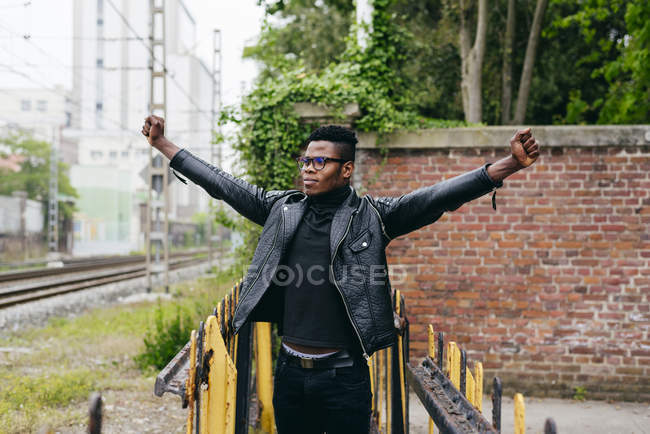 Black man standing on street with hands up — Stock Photo