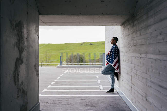 Trendy hipster leaning on wall — Stock Photo