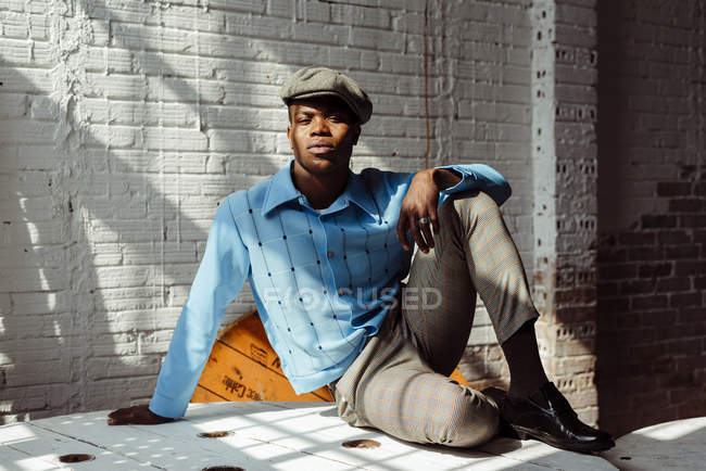 Stylish black man sitting on floor — Stock Photo