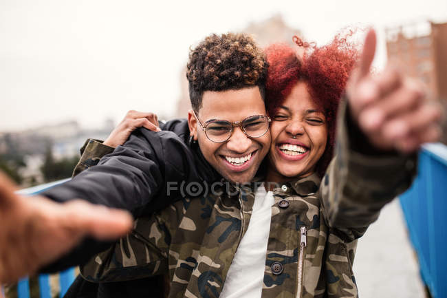 Cheerful couple embracing and laughing — Stock Photo